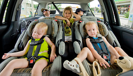 child vacation road trip drive car seat
